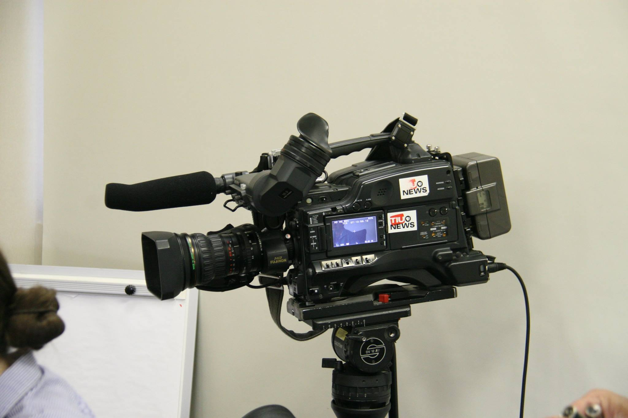 Video Camera filming the interview